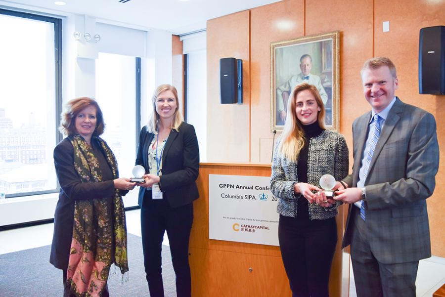 [CLICK TO ENLARGE] Dean Merit E. Janow (left) and Dean of Student Affairs Cory Way (right) joined Shanna Crumley (left) and Gemma Torras Vives, winners of the 2018 GPPN student competition.