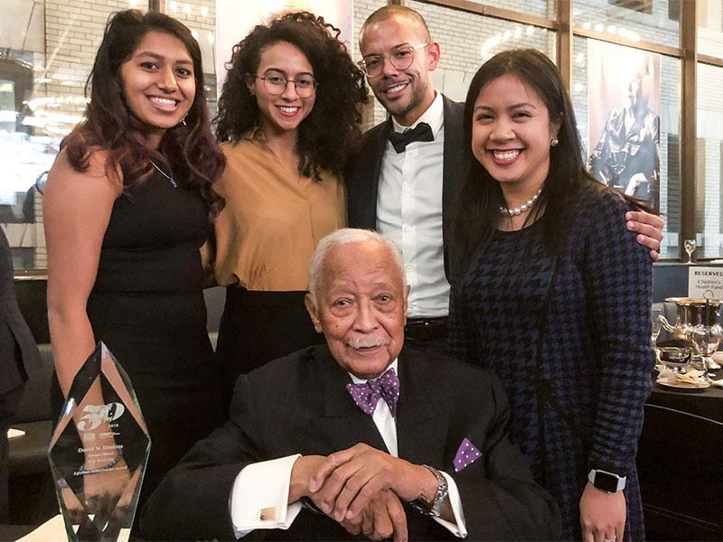 Mayor David Dinkins was joined by current students (from left) Divya Sundaram, Hadiya Housepian,  Joshua Elder, and Katarina Mayers.