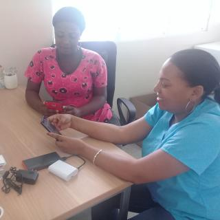 A nurse and a community promoter use the Internet-in-a-Box, Dominican Republic