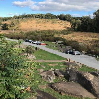 """Students analyzed the Union defense of locations like Little Round Top, seen here from the perspective of """"Devil's Den,"""" a rock formation from which Confederate troops launched an attack."""